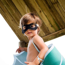 Toddler boy playing with The Doudoods black superhero dress up mask bandit style
