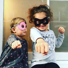 Supergirls playing with The Doudoods bandit dress up mask and pink heart eye patch