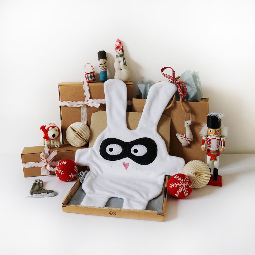 The Doudoods white + black bandit style baby comforter with Christmas presents