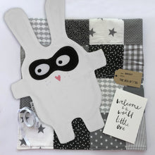 The Doudoods white + black bandit style baby comforter with grey patchwork blanket and Welcome to the world card