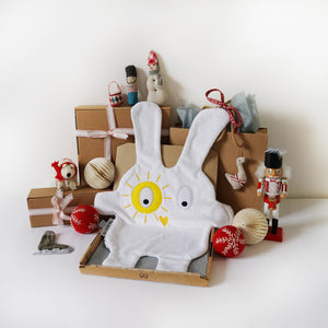 The Doudoods white + yellow sunshine style baby comforter with Christmas presents