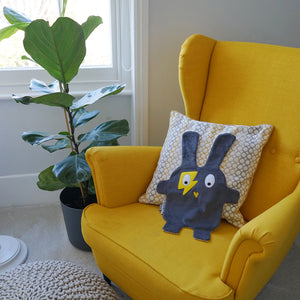 The Doudoods grey + yellow flash style baby comforter on yellow feeding chair