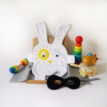 The Doudoods white + yellow sunshine style baby comforter with black bandit mask as featured in the sibling pack