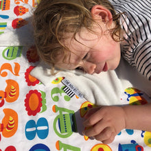 Post swimming toddler having a cuddle with The Doudoods white + yellow sunshine style baby comforter