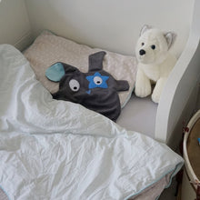 The Doudoods grey + blue star style baby comforter in toddler bed