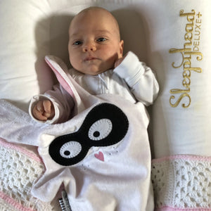 Newborn cuddling The Doudoods white + black bandit style baby comforter in sleepyhead