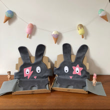 Two grey + pink The Doudoods baby comforters in Flash and Star style in boxes with ice cream bunting