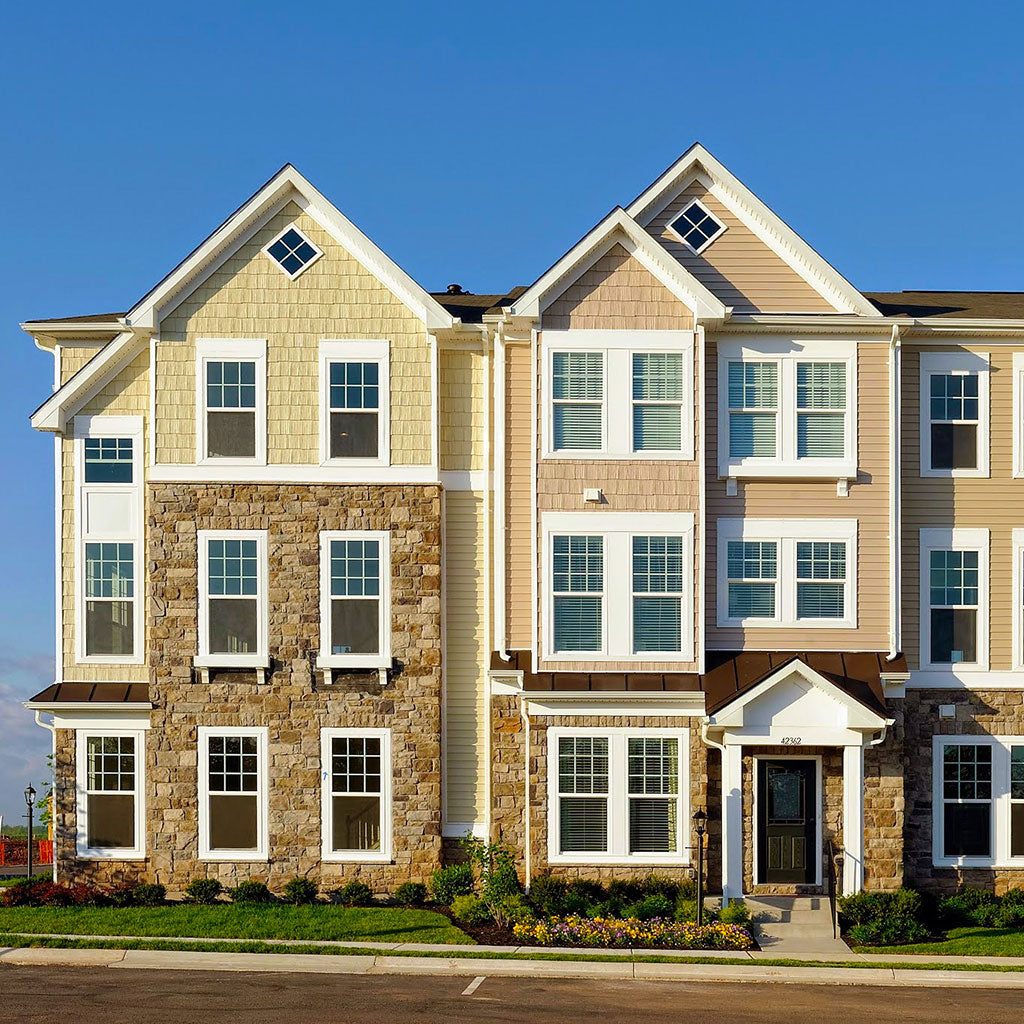 Townhouses with architectural faux windows.