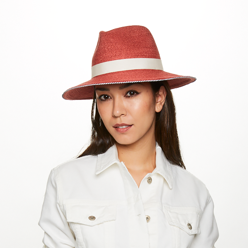 Model wears the Courtney fedora in terracotta with ivory trim from the Eugenia Kim Resort 2020 Collection.
