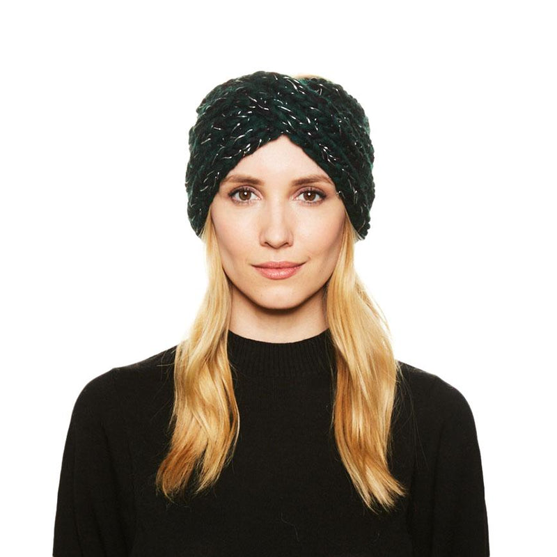 A blonde haired female model wears the Eugenia Kim chunky knit wool Lula headband in Hunter
