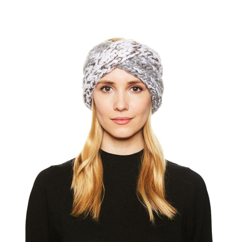 A blonde haired female model wears the Eugenia Kim chunky knit wool Lula headband in Winter White/Gray