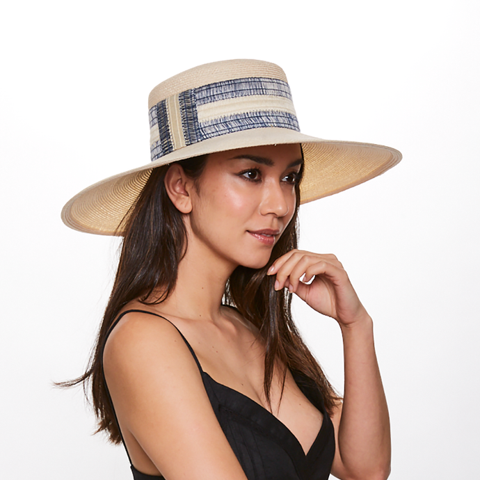 Brunette model wears Eugenia Kim Loulou Ivory Hemp Boater