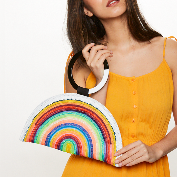 Model holding Eugenia Kim Luna Clutch in Multi Stripe