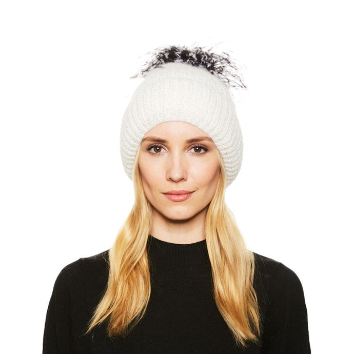 Female Model with blonde hair wears the Eugenia Kim Maddox angora knit beanie in Winter White with Black and White Ostrich feather pom