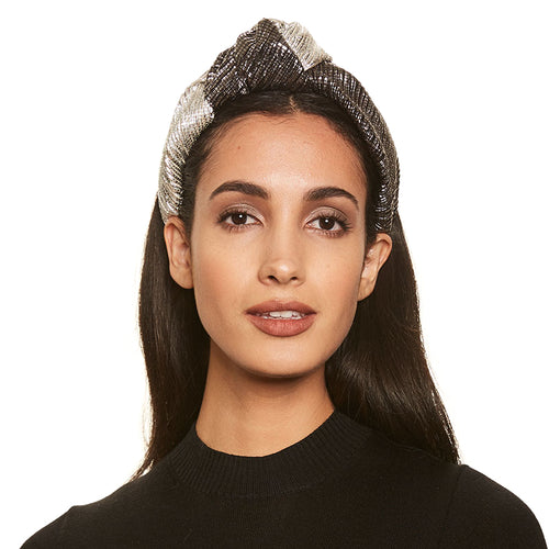 Model wearing Eugenia Kim Pre-Fall 2019 Maryn knotted headband in Silver/Gunmetal lamé