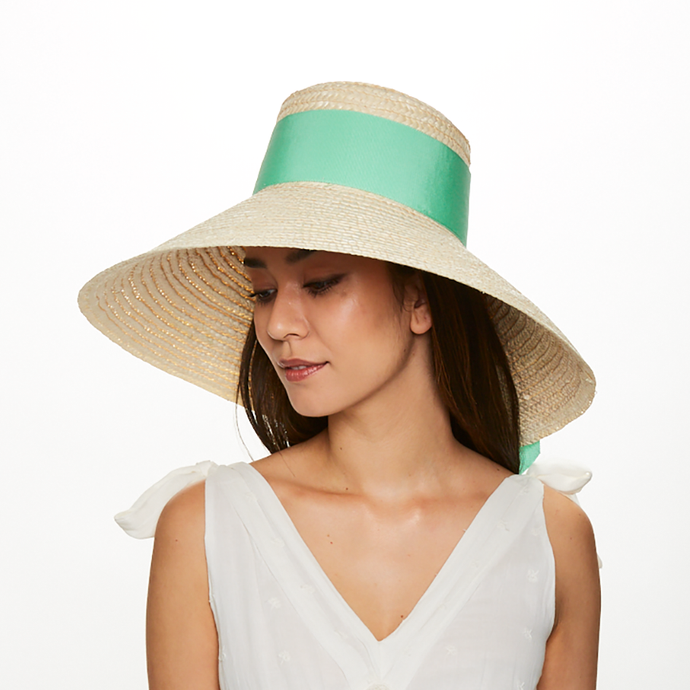 Brunette model wears Eugenia Kim Mirabel straw sunhat in Ivory with mint grosgrain
