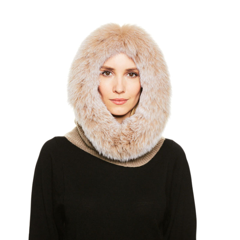 A female model wears the Eugenia Kim Paulina cashmere knit hood with fox fur trim