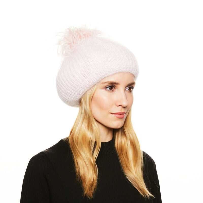 Model with blonde hair wears the Eugenia Kim Rochelle knit angora beret in Pale Pink