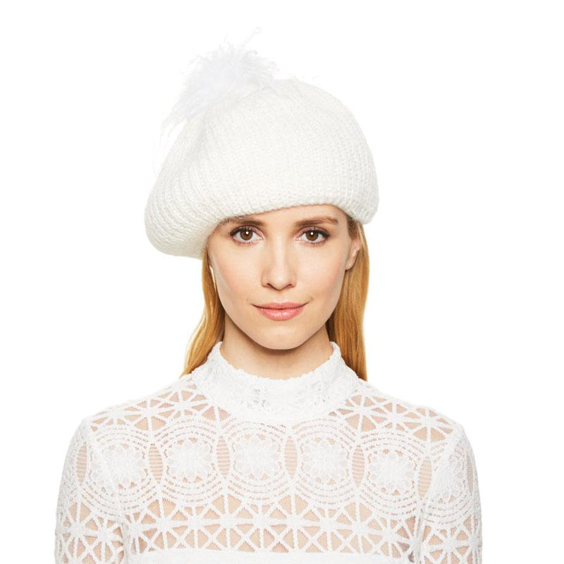 White female model with blonde hair wearing the Eugenia Kim Bridal Rochelle angora knit beret in Winter White with white ostrich pom