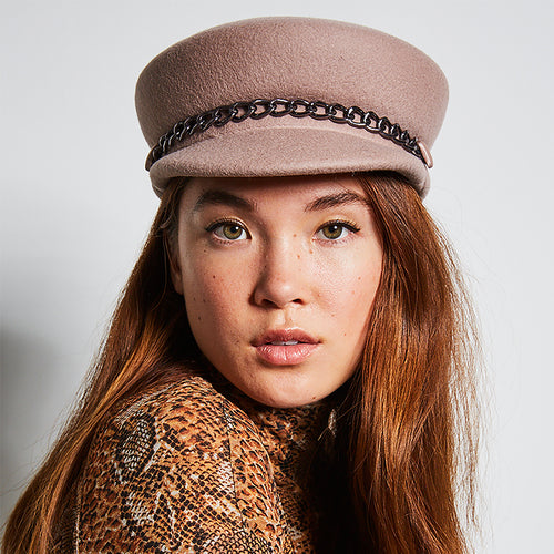 Front view of model wearing the Sabrina wool felt cap with gunmetal chain by hat designer Eugenia Kim