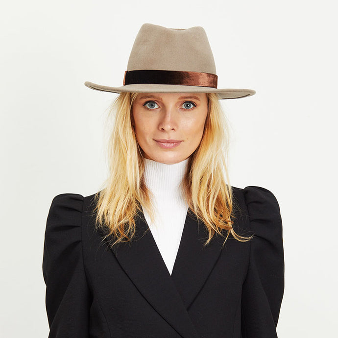 Blonde female model wearing the Eugenia Kim Blaine fedora in Mink rabbit felt and bronze band.