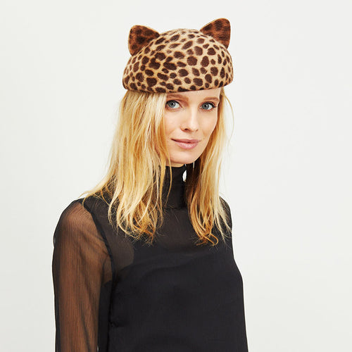 Female model with blonde hair wearing Eugenia Kim Caterina cat-ear beret in leopard print