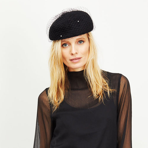 Female blonde model wears Eugenia Kim Coco Beret in Black rabbit felt with Black Crystal Veil