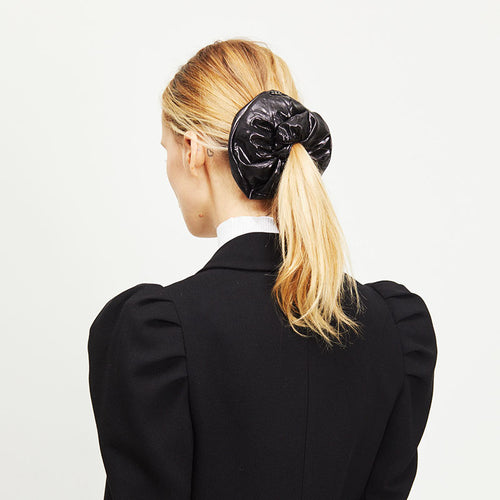 Female model with blonde hair wearing Eugenia Kim Mallory Scrunchie in Black Lamé