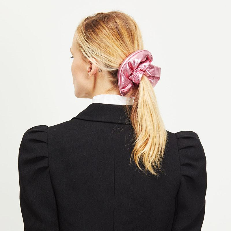 Female model with Blonde Hair wearing Eugenia Kim Mallory Scrunchie in Pink Lamé