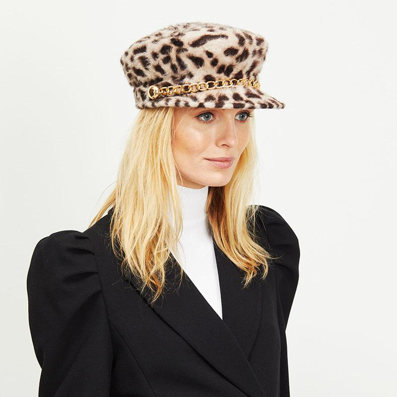Blonde female model wearing Eugenia Kim Ocelot print Sabrina cap