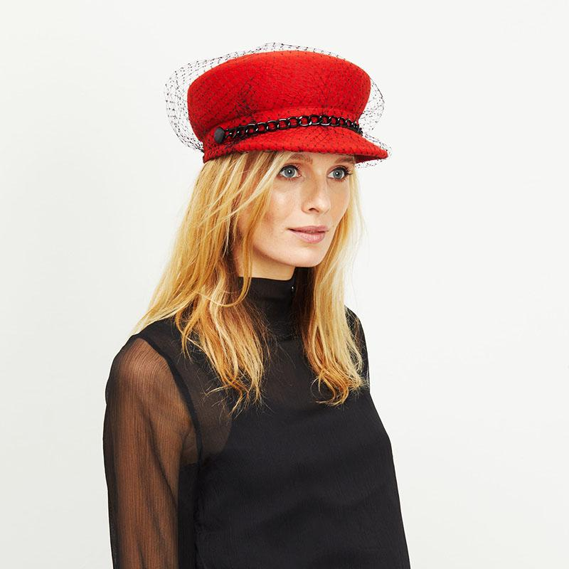 Blonde female model wears Eugenia Kim Red Sabrina Cap with Black veil