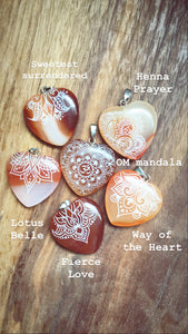 small red carnelian agate hearts engraved with henna designs