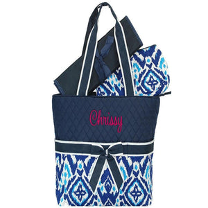 Personalized this Ikat Navy Diamond Diaper Bag, comes with changing pad and a zipping accessory pouch.