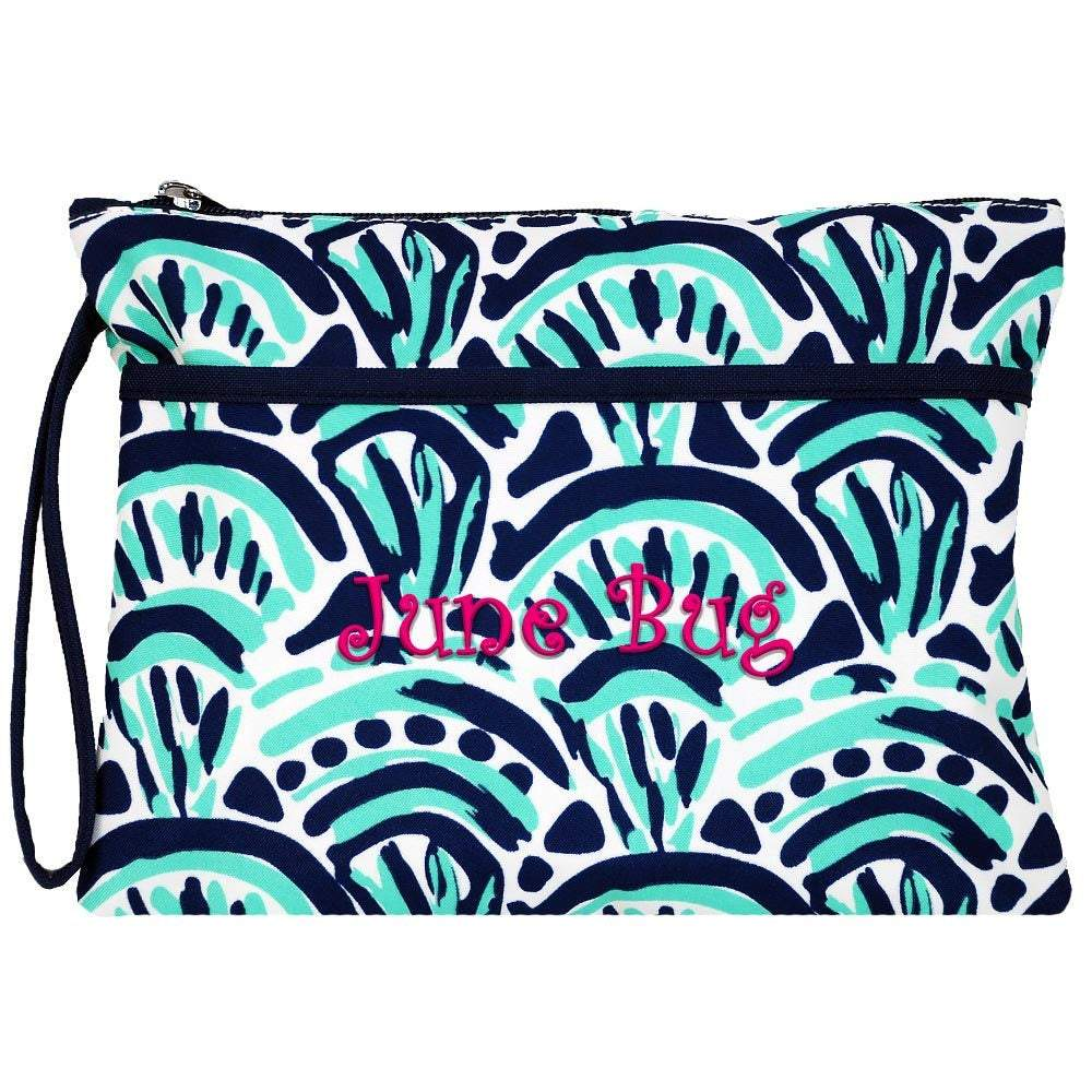 Personalized this stylish waves print wristlet style cosmetic bag with navy trim is perfect as a day-to-day purse or as a personalized gift!