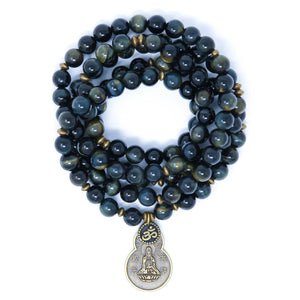 Blue Tiger Eye Mala beads with antique brass details, small Om charm and Quan Yin pendant.