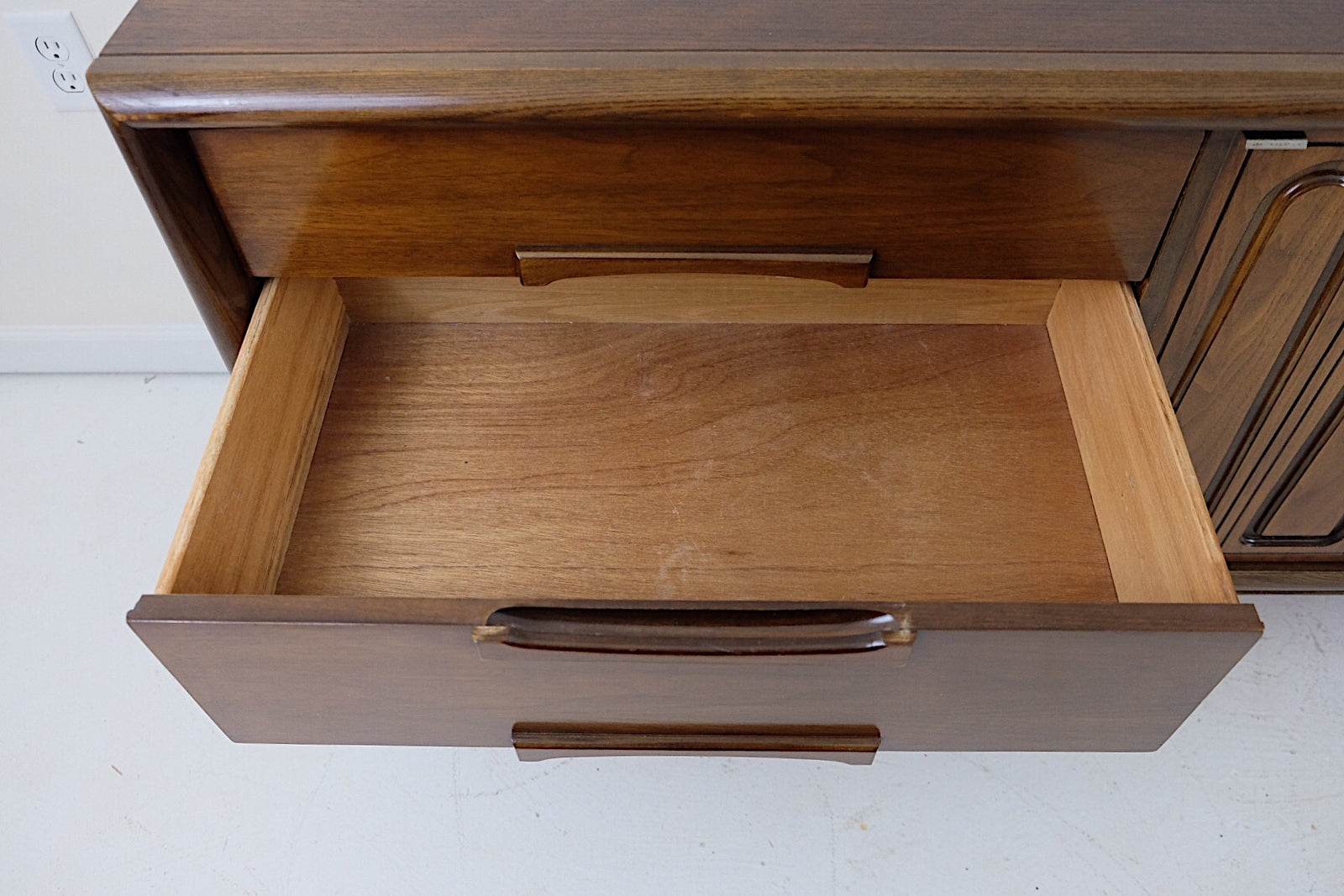 Bassett Mid Century Modern Lowboy Dresser Credenza Carved Details Outlook Collection by Leo Jiranek Nine Drawers