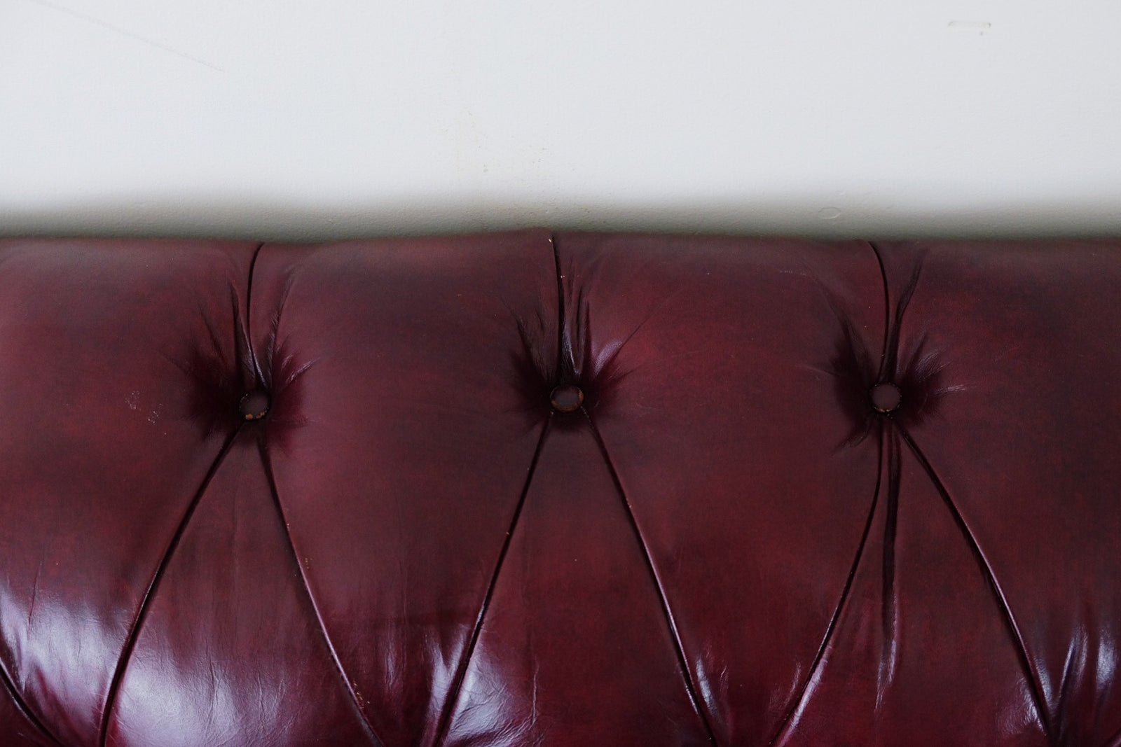 Oxblood Leather Chesterfield Style Loveseat Tufted Wooden Legs Brass Studs