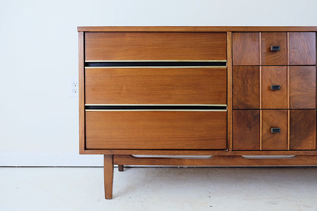 Lane Attributed Walnut Veneer Black and Gold Hardware Detail Mid Century Modern Low Dresser Nine Drawers