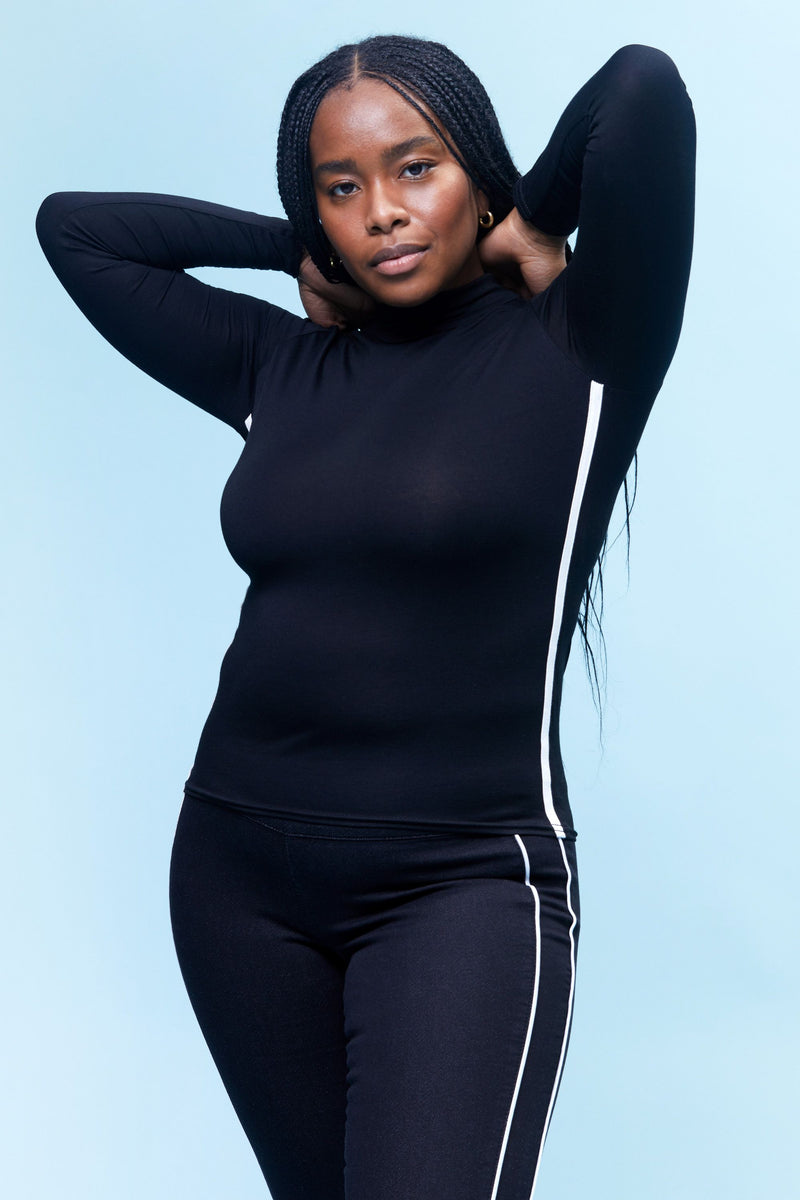 "Freedom Curvy Knit Denim High Rise Pull On 28"" Legging With Contrast Piping Detail In Black"