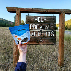 help prevent wildfires sign with freeze dried food when camping