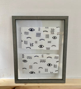 Framed fabric with eye design