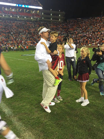 Lane Kiffin on the sideline with his children.