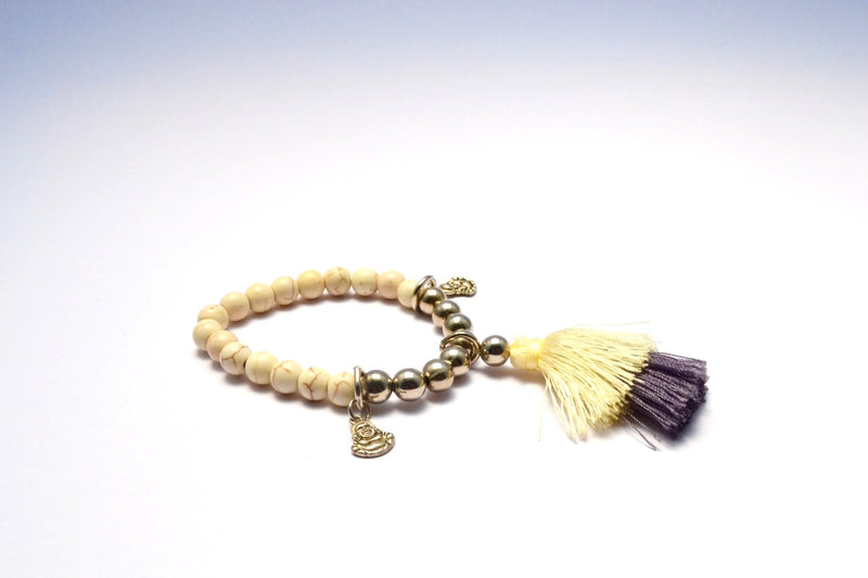 CREMA STONE WITH TINY BUDDHA BANGLES & FAUX SILVER ROUND BEADS W MULTICOLORED TASSEL BRACELET.