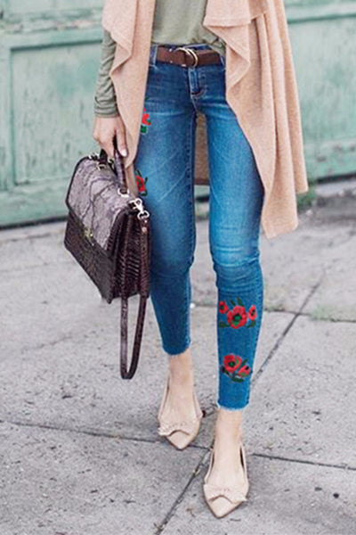 Embroidered flowers ripped slimming jeans