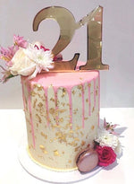 double height tall cake buttercream smooth icing gold flakes macarons flowers floral chocolate drip birthday 21 21st