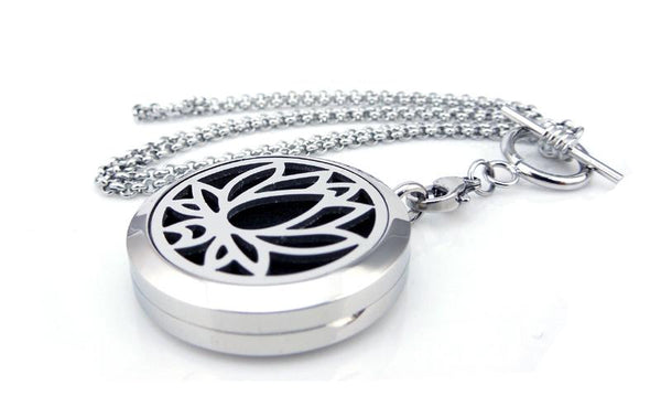Love & Light Essence. Silver Essential Oil Diffuser Necklace 100% Surgical Grade 316L Stainless Steel Lotus Flower 2 Front On Lying Down View