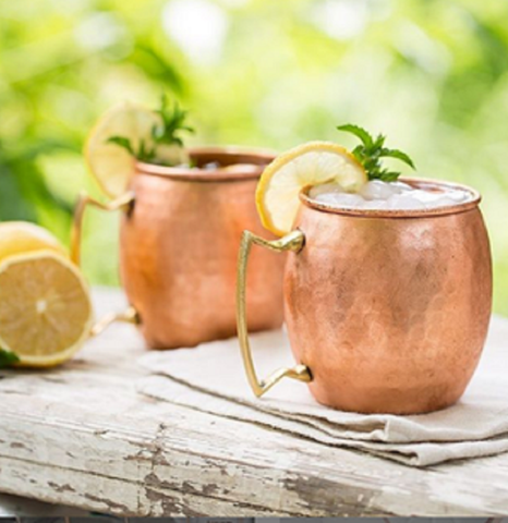 copper mugs with Moscow mule