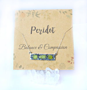 Peridot balance and compassion card holding peridot crystal necklace