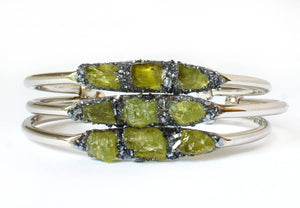3 green peridot stone set in crushed pyrite bracelets with gold plated band