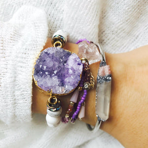 woman wearing druzy jewelry and Natural Pink Tourmaline and Angel Aura Quartz bracelet on her wrist